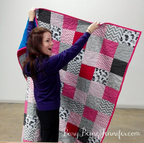 The exact moment that Taylor realized it was pink trucks and high heels on her quilt!  - BusyBeingJennifer.com
