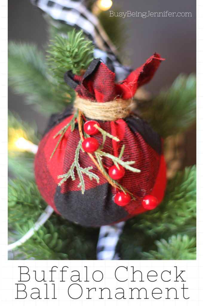 I love the fresh clean farmhouse look of buffalo check year round but I also love incorporating it into my Christmas decorating! Just like this Buffalo Check Ball Ornament.